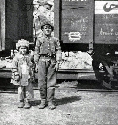 'This brother and sister, orphans, were begging for a train-ride to some other town, where there might be bread' (Nat. Geog: Volume XXXVI, Number Five, November 1919, p. 404