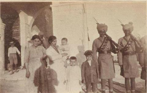 Indian soldiers with Armenian orphans*