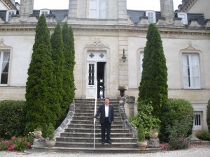 Zhang stands on the steps of his Chateau Grand Moueys
